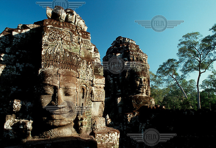 Some of the hundreds of faces thought to be those of Khmer king Jayavarman VII decorating the Bayon, the state Buddhist temple which dominates the ancient city of Angkor Thom.