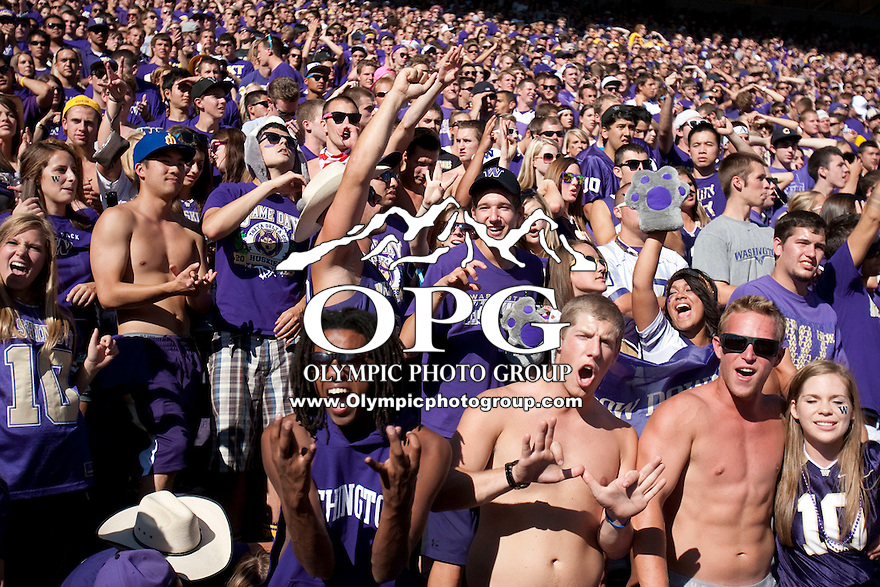 Sept 3, 2011:  Washington fans cheer on the Huskies against Eastern Washington.  Washington defeated Eastern Washington 30-27 at Husky Stadium in Seattle, Washington...