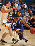 SIOUX FALLS, SD - MARCH 10:   Aaron Washington #12 from UMKC drives against Marshall Bjorklund #42 from North Dakota State University in the second half of their semifinal game Sunday evening at the 2013 Summit League Basketball Tournament in Sioux Falls. SD. (Photo by Dave Eggen/Inertia)