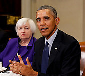 US President Barack Obama speaks to the press after a meeting with financial regulators to receive an update on their progress in implementing Wall Street Reform, while Janet Yellen (L) Chair, Federal Reserve Board of Governors listens, in the Roosevelt Room of the White House, in Washington, DC, March 7, 2016.  <br /> Credit: Aude Guerrucci / Pool via CNP