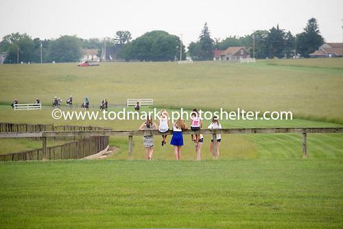 Kids watch the field make a downhill run in the timber allowance at Fair Hill.