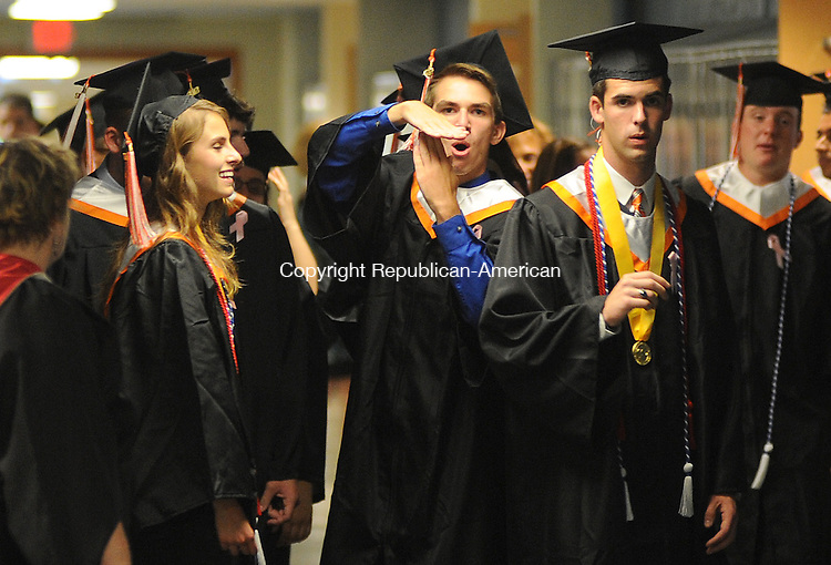 WATERTOWN, CT-14 JUNE 2012--061512JS02-Jonathan Perkins, center, calls a time out as graduates line up for to graduation as Valedictorian Claudia Ghisa, left, and Salutatorian William Crotty, Jr., look on prior to ceremonies Friday at Watertown High School. He called a time out because they were missing two students from the procession line. . Jim Shannon Republican-American
