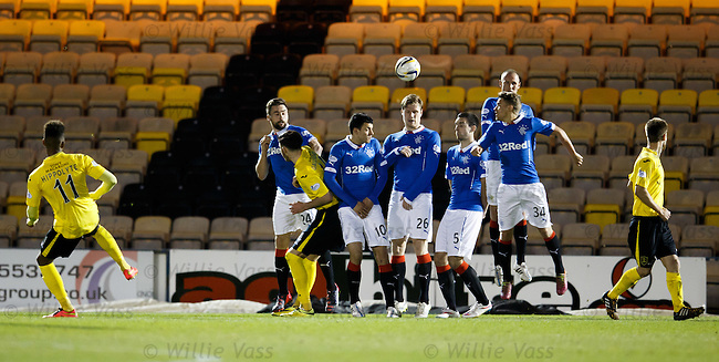 Myles Hippolyte curls the ball over the Rangers wall to score for Livingston