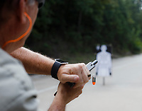 NWA Democrat-Gazette/CHARLIE KAIJO A state park ranger practices a weapon malfunction drill called a &quot;stovepipe&quot; during the Arkansas State Parks firearm training, Monday, September 10, 2018 at the Hobbs State Park shooting range in Rogers. The drill allows rangers to practice responding to a scenario where a bullet casing becomes lodged in the ejection port of their pistol.<br />