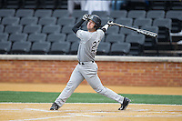 Michael Pierson (22) of the Appalachian State Mountaineers follows through on his swing against the Wake Forest Demon Deacons at Wake Forest Baseball Park on February 13, 2015 in Winston-Salem, North Carolina.  The Mountaineers defeated the Demon Deacons 10-1.  (Brian Westerholt/Four Seam Images)
