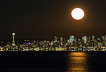 The full Wolf moon – or January's full moon rises over Seattle Washington on January 12, 2017. It is thought to have been dubbed the wolf moon by Native American tribes because at this time of year wolves would often howl in their search for scarce prey.     ©2017. Jim Bryant Photo. All Rights Reserved.