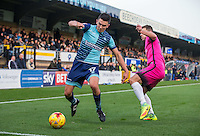 Luke O'Nien of Wycombe Wanderers goes past Nicky Deverdics of Hartlepool United to assist for the first goal during the Sky Bet League 2 match between Wycombe Wanderers and Hartlepool United at Adams Park, High Wycombe, England on 26 November 2016. Photo by Andy Rowland / PRiME Media Images.