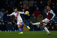 30th November 2019; Turf Moor, Burnley, Lanchashire, England; English Premier League Football, Burnley versus Crystal Palace; Martin Kelly of Crystal Palace crosses into the Burnley area as Dwight McNeil challenges - Strictly Editorial Use Only. No use with unauthorized audio, video, data, fixture lists, club/league logos or 'live' services. Online in-match use limited to 120 images, no video emulation. No use in betting, games or single club/league/player publications