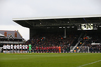 17th March 2018, Craven Cottage, London, England; EFL Championship football, Fulham versus Queens Park Rangers; Both Fulham and Queens Park Rangers players stand in the centre circle for a minute's applause for the recent passing of former Fulham player Stan Brown before kick off