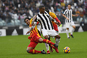 5th November 2017, Allianz Stadium, Turin, Italy; Serie A football, Juventus versus Benevento; Nicolas Viola and Raman Chibsah sandwich Douglas Costa