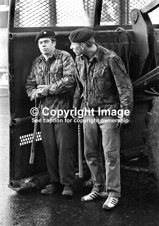 British Army snatch squard, one of them wearing running shoes, on the look-out for ringleaders. Exact Belfast location not known. NI Troubles. Ref: 19721201007...Copyright Image from Victor Patterson, 54 Dorchester Park, Belfast, UK, BT9 6RJ..Tel: +44 28 9066 1296.Mob: +44 7802 353836.Voicemail +44 20 8816 7153.Skype: victorpattersonbelfast.Email: victorpatterson@mac.com.Email: victorpatterson@ireland.com (back-up)..IMPORTANT: If you wish to use this image or any other of my images please go to www.victorpatterson.com and click on the Terms & Conditions. Then contact me by email or phone with the reference number(s) of the image(s) concerned.