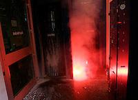 Una torcia lanciata da alcuni studenti all'entrata di una filiale della banca Unicredit, durante una manifestazione a Roma, 7 ottobre 2011..A torch flame thrown by students at the entrance of a Unicredit bank branch, during a demonstration in Rome, 7 october 2011..UPDATE IMAGES PRESS/Riccardo De Luca