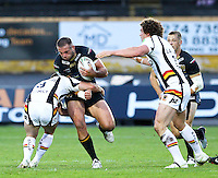 PICTURE BY ALEX WHITEHEAD/SWPIX.COM - Rugby League - Super League - Bradford Bulls vs Hull FC - Odsal Stadium, Bradford, England - 01/09/12 - Hull FC's Andy Lynch is tackled by Bradford's Heath L'Estrange.
