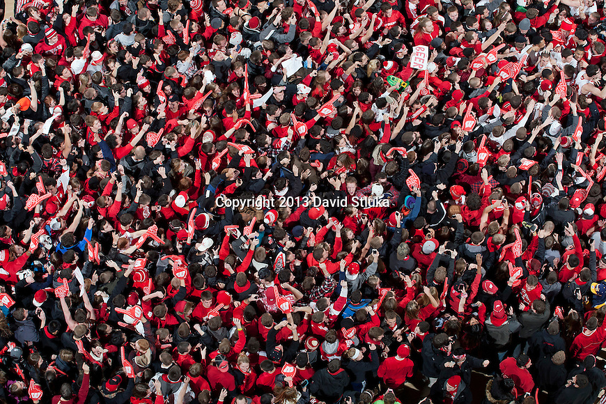 An overhead view as the Wisconsin Badgers fans rush the floor during a Big Ten Conference NCAA college basketball game against the Michigan Wolverines Saturday, February 9, 2013, in Madison, Wis. The Badgers won 65-62 (OT) (Photo by David Stluka)