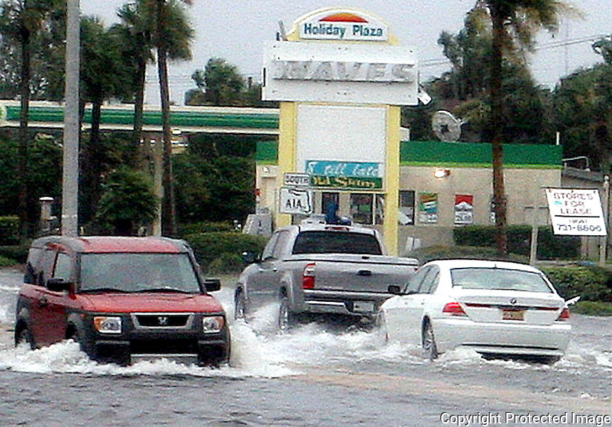 Gary Wilcox/staff-- 08/23/08- Cars drove on a flooded  Third Street North . in Jacksonville Beach  during the end of  Tropical Storm Fay on Friday  (August 22, 2008). (The Florida Times-Union,Gary Wilcox)...