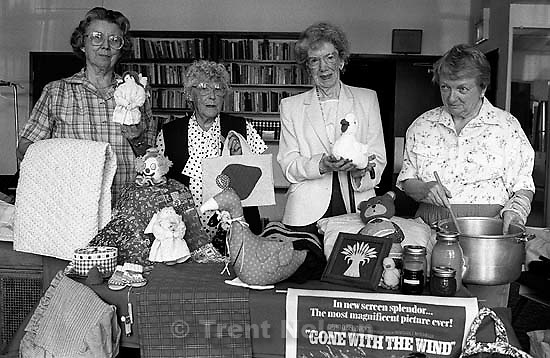 Women with things for sale at a Presbyterian Church event.<br />