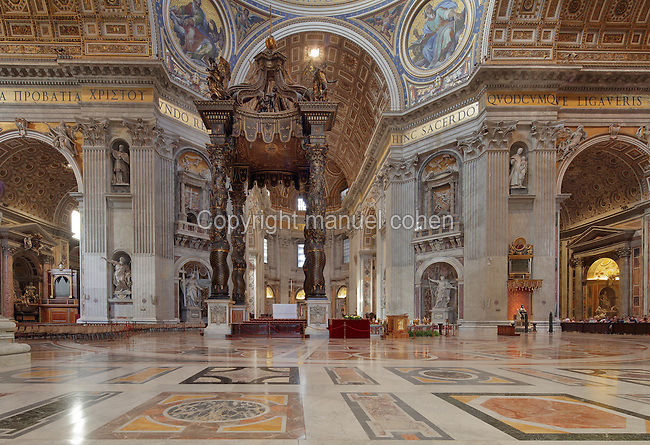 Interior of St Peter's Basilica, a Renaissance church designed by Donato Bramante, Michelangelo, Carlo Maderno and Gian Lorenzo Bernini and built 1506-1626, in the Piazza San Pietro or St Peter's Square, Vatican City, Rome, Italy. Beneath the dome is the baldacchino by Bernini, made of bronze in Baroque style. Picture by Manuel Cohen