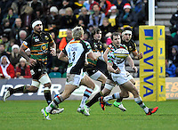 Northampton, England. Nick Evans of Harlequins passes to Matt Hopper of Harlequins during the Aviva Premiership match between Northampton Saints and Harlequins at Franklin's Gardens on December 22. 2012 in Northampton, England.