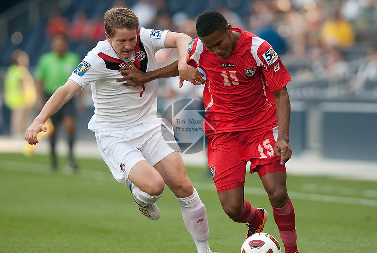 14 June 2011                         Canada midfielder Terry Dunfield (7) and Panama defender Erick Davis (15) push each other as they both go for the ball in the first half. The Panama Men's National Soccer Team played against the Canada Men's National Soccer Team in the first qualifying round of the CONCACAF Gold Cup game at Livestrong Sporting Park in Kansas City, KS on June 14, 2011.