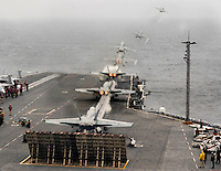 Photo merge of an F/A-18C Hornet launch aboard USS Abraham Lincoln.