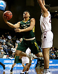 SIOUX FALLS, SD - MARCH 20: C.J. Asuncion-Byrd #15 from Le Moyne scoops the ball to the basket past Gage Primm #24 from West Texas A&M during their quarterfinal game at the 2018 Elite Eight Men's NCAA DII Basketball Championship at the Sanford Pentagon in Sioux Falls, SD. (Photo by Dave Eggen/Inertia)