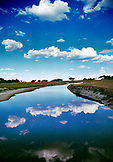 BOTSWANA, Africa, Okavango Delta, Clouds reflecting in the Okavango River