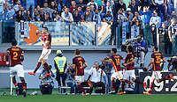 Calcio, Serie A: Roma vs Lazio. Roma, stadio Olimpico, 8 novembre 2015.<br /> Roma's Edin Dzeko, second from left, celebrates with teammates after scoring on a penalty kick during the Italian Serie A football match between Roma and Lazio at Rome's Olympic stadium, 8 November 2015.<br /> UPDATE IMAGES PRESS/Riccardo De Luca