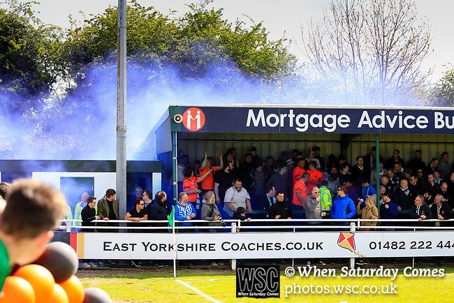 Fans celebrating AFC Flyde's goal let off a blue flare. Vanarama National League North, Promotion Final, North Ferriby United v AFC Fylde, 14th May 2016.