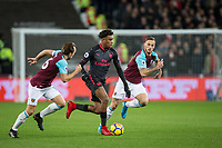 Alex Iwobi of Arsenal under pressure from Marko Arnautovic of West Ham United during the Premier League match between West Ham United and Arsenal at the Olympic Park, London, England on 13 December 2017. Photo by Andy Rowland.