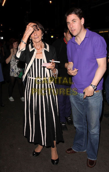 """JUNE BROWN.Seen outside the Noel Coward Theatre where she is currently starring as Miss January in the West End production of """"Calendar Girls"""", London, England, UK, July 28th 2009..on cast change night full length black and white trim jacket striped skirt fan hand on touching head  long dress.CAP/AH.©Adam Houghton/Capital Pictures"""