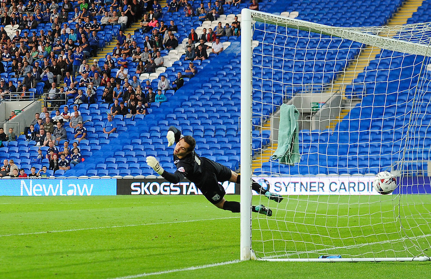 GOAL - AFC Wimbledon's James Shea is beaten by Cardiff City's Craig Noone free kick to put Cardiff City into the lead<br /> <br /> Photographer Craig Thomas/CameraSport<br /> <br /> Football - Capital One Cup First Round - Cardiff City v AFC Wimbledon - Tuesday 11th August 2015 - Cardiff City Stadium - Cardiff <br /> &copy; CameraSport - 43 Linden Ave. Countesthorpe. Leicester. England. LE8 5PG - Tel: +44 (0) 116 277 4147 - admin@camerasport.com - www.camerasport.com