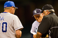 Rice Owls head coach Wayne Graham #37 goes over the lineup with home plate umpire David Rogers and Kentucky Wildcats head coach Gary Henderson #20 at Minute Maid Park on March 4, 2011 in Houston, Texas.  Photo by Brian Westerholt / Four Seam Images
