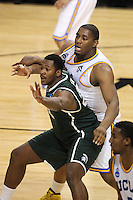 Michigan State Spartans Derrick Nix #25 flights for position against UCLA Bruins Joshua Smith #34 during the second round game of the NCAA Basketball Tournament at St. Pete Times Forum on March 17, 2011 in Tampa, Florida.  UCLA defeated Michigan State 78-76.  (Mike Janes/Four Seam Images)