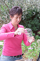 Christine Saurel owner vinifying glasses domaine montirius vacqueyras rhone france