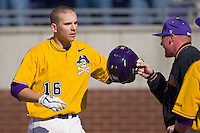 John Wooten #16 of the East Carolina Pirates is congratulated by a teammate after hitting a home run in his first collegiate at bat at Clark-LeClair Stadium on February 20, 2010 in Greenville, North Carolina.   Photo by Brian Westerholt / Four Seam Images