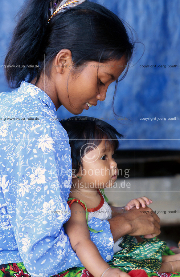 CAMBODIA Mekong River, young woman with child / KAMBODSCHA Mekong Fluss, junge Frau mit Kind