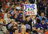Jan. 4, 2010; Glendale, AZ, USA; A fan holds a sign critical of the BCS during the game between the TCU Horned Frogs against the Boise State Broncos in the 2010 Fiesta Bowl at University of Phoenix Stadium. Boise State defeated TCU 17-10. Mandatory Credit: Mark J. Rebilas-