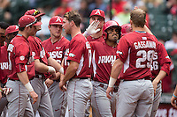Michael Bernal (3) of the Arkansas Razorbacks high fives teammate Cullen Gassaway (29) after hitting a 2-run home run against the Texas Tech Red Raiders in gave seven of the Shriners Hospitals for Children College Classic at Minute Maid Park on February 28, 2016 in Houston, Texas.  The Razorbacks defeated the Red Raiders 10-6.  (Brian Westerholt/Four Seam Images)