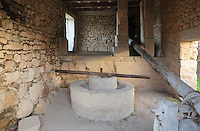Reconstructed Roman oil press, Volubilis, Northern Morocco, where olive growing was the main industry. Volubilis was founded in the 3rd century BC by the Phoenicians and was a Roman settlement from the 1st century AD. Volubilis was a thriving Roman olive growing town until 280 AD and was settled until the 11th century. The buildings were largely destroyed by an earthquake in the 18th century and have since been excavated and partly restored. Volubilis was listed as a UNESCO World Heritage Site in 1997. Picture by Manuel Cohen