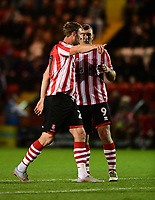 Lincoln City's Jamie McCombe, left, with team-mate Matt Rhead<br /> <br /> Photographer Chris Vaughan/CameraSport<br /> <br /> The EFL Checkatrade Trophy Group H - Lincoln City v Mansfield Town - Tuesday September 4th 2018 - Sincil Bank - Lincoln<br />  <br /> World Copyright © 2018 CameraSport. All rights reserved. 43 Linden Ave. Countesthorpe. Leicester. England. LE8 5PG - Tel: +44 (0) 116 277 4147 - admin@camerasport.com - www.camerasport.com