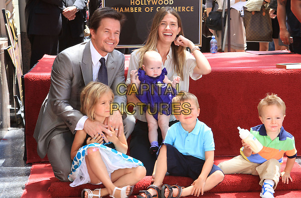 MARK WAHLBERG, RHEA DURHAM & CHILDREN Ella Rae, Grace Margaret, Michael and Brendan Joseph.Mark Wahlberg is honored on The Hollywood Walk of Fame with the 2414th Star, Hollywood, CA, USA, .29th July 2010..full half length grey gray suit tie shirt kids family son sons baby daughter daughters married husband wife couple sitting kneeling .CAP/ADM/FS.©Faye Sadou/AdMedia/Capital Pictures.