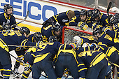 The Warriors gather around Rasmus Tirronen (Merrimack - 32). - The Boston College Eagles defeated the visiting Merrimack College Warriors 2-1 on Wednesday, January 21, 2015, at Kelley Rink in Conte Forum in Chestnut Hill, Massachusetts.