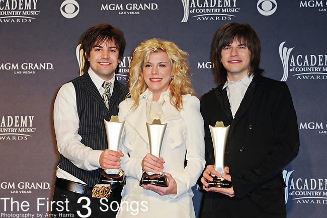 Neil Perry, Kimberly Perry and Reid Perry of The Band Perry with awards in the press room of the 46th Annual Academy of Country Music Awards in Las Vegas, Nevada on April 3, 2011.  The Band Perry won Top New Artist and Top New Duo/Group.