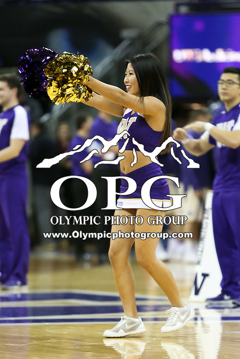 SEATTLE, WA - DECEMBER 18: Washington cheerleader Jackie Lin entertained fans during a timeout break against Western Michigan.  Washington won 92-86 over Western Michigan at Alaska Airlines Arena in Seattle, WA.