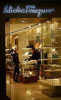 Shoppers shop for luxury brands at China World Trade Center, Beijing, China. .21 Jan 2006