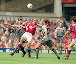 Roy Keane of Manchester Utd tussles with Mark Draper of Aston Villa - Barclays Premier League - Aston Villa v Manchester Utd - Villa Park Stadium - Birmingham - England - 19th August 1995 - Picture Sportimage