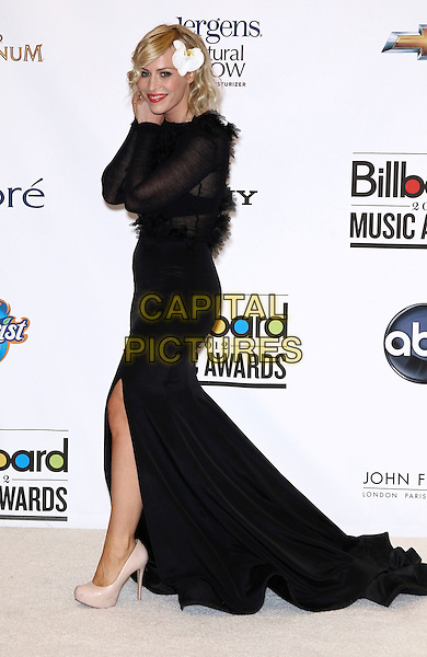 Natasha Bedingfield.2012 Billboard Music Awards Press Room at the MGM Grand Garden Arena Las Vegas, Las Vegas, Nevada, USA..May 20th, 2012.full length black dress feathers slit split side hand arm.CAP/ADM/MJT.© MJT/AdMedia/Capital Pictures.