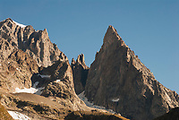 Spires of rock jut up from the Mont Blanc Massif, seen from near Lac du Miage.