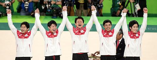 (L-R) Koji Yamamuro, Kohei Uchimura, Yusuke Tanaka, Kenzo Shirai, Ryohei Kato (JPN),<br /> AUGUST 8, 2016 - Artistic Gymnastics :<br /> Gold medalists Koji Yamamuro, Kohei Uchimura, Yusuke Tanaka, Kenzo Shirai and Ryohei Kato of Japan celebrate on the podium during the Men's Team Medal Ceremony at Rio Olympic Arena during the Rio 2016 Olympic Games in Rio de Janeiro, Brazil. (Photo by Enrico Calderoni/AFLO SPORT)