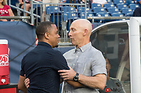 FOXBOROUGH, MA - AUGUST 3: Charlie Davies former US National Team and NE Revolution player greets Bob Bradley of Los Angeles FC before the game during a game between Los Angeles FC and New England Revolution at Gillette Stadium on August 3, 2019 in Foxborough, Massachusetts.